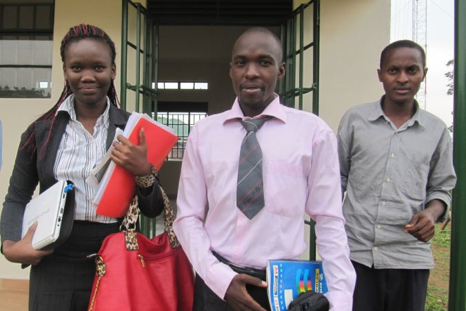 cbs-radio-journalist-ronald-ssembuusi-middle-leaving-court-with-hrnj-uganda-lawyer-catherine-anite-left